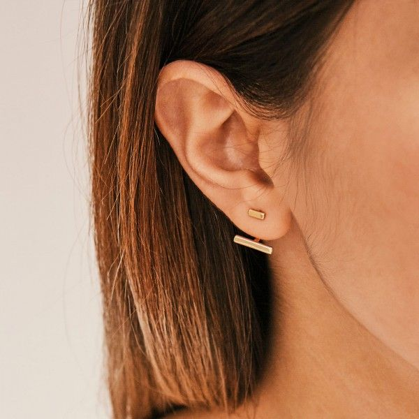 Twin gold earrings detail
